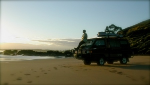 Lonna and I at sunrise in Takou Bay before a surf session.
